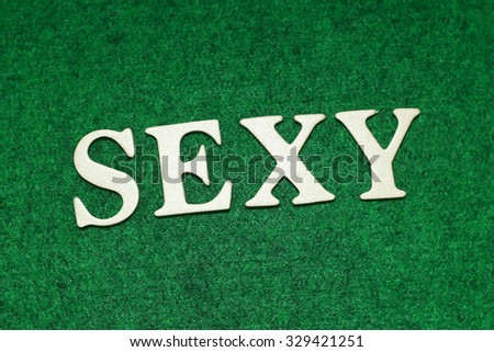 The Sexy word on rusty green background. Business concept - stock photo