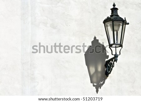The shadow of Prague's ancient lamps - stock photo