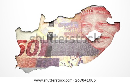 The shape of the country of South Africa in the colours of its rand currency recessed into an isolated white surface - stock photo