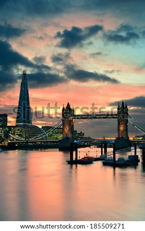 The Shard and Tower Bridge over Thames River in London at dusk. - stock photo