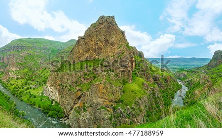 The sharp coned rock with the ruins of the Tmogvi Castle on the slope, Samtskhe-Javakheti Region, Georgia.