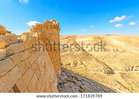 The Shawbak castle of a Crusader in Shawbak, Jordan.  - stock photo