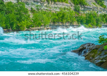 The shear power and beauty of nature are highlighted in this photograph of the whirlpool rapids on the Niagara River. - stock photo