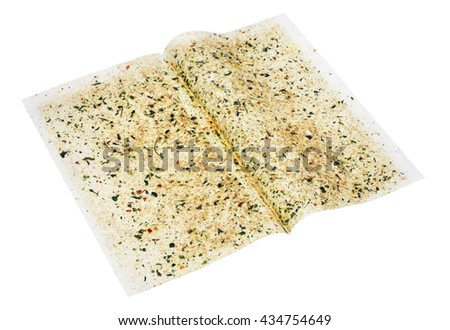 The sheet of culinary paper for roasting of chicken fillet is sprinkled spices- pepper, parsley, fennel, rosemary,  basil  and salt. Isolated with patch