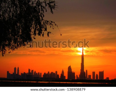 The Sheikh Zayed Road skyline in Dubai at sunset. - stock photo