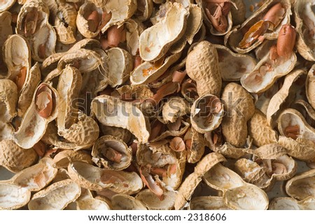 The shells of cracked peanuts from above. - stock photo