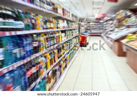The shelves in the supermarket. The focus in the center of the frame
