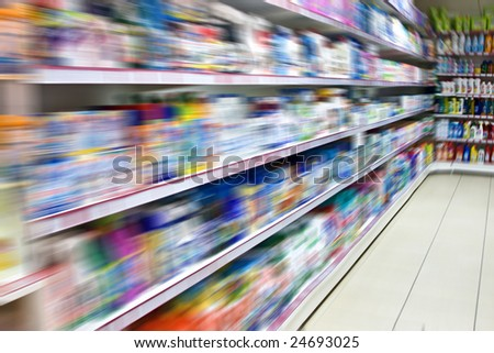 The shelves with goods in a supermarket - stock photo