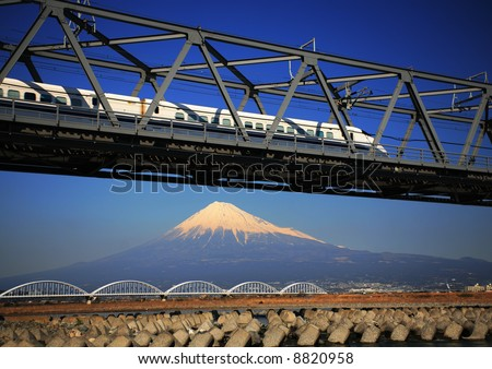 The Shinkansen runs over Mt,Fuji peak - stock photo