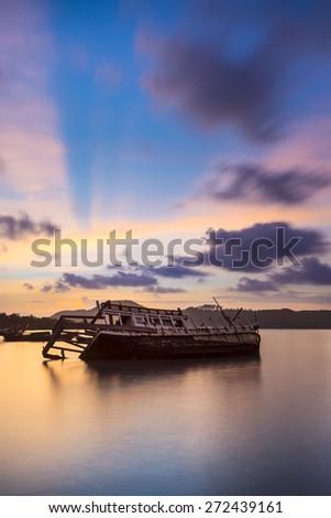 The ship capsized sunrise Phuket thailand 1 - stock photo