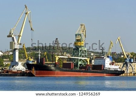 The ship on loading in port. - stock photo