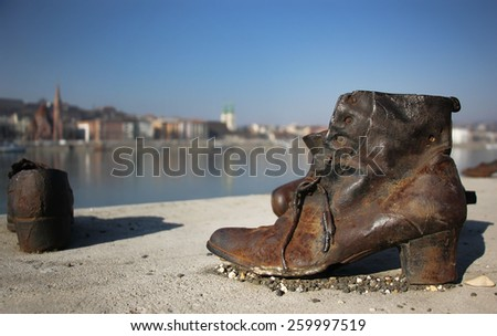 The Shoes on the Danube Bank monument in Budapest, Hungary, was built in memory of the jews who were killed by fascist Arrow Cross militiamen in Budapest during World War II - stock photo