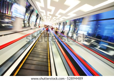 the shopper gong on the escalator in shopping. - stock photo