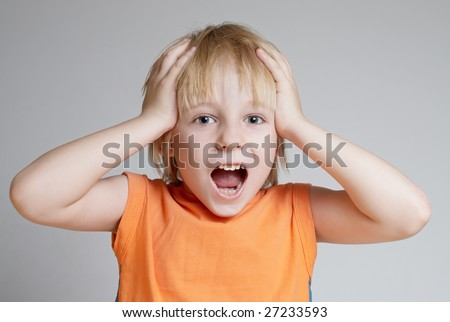 The shouting emotional boy - stock photo
