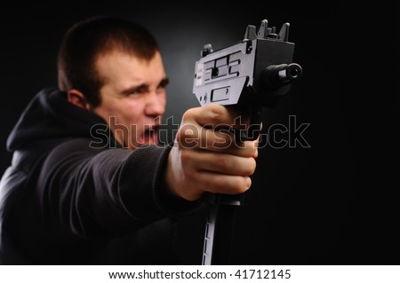 The shouting man with pair of uzi - stock photo