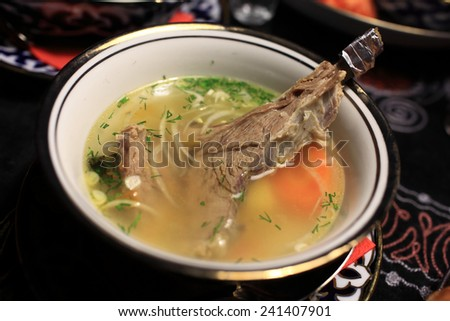 The shurpa soup in the plate on a table - stock photo