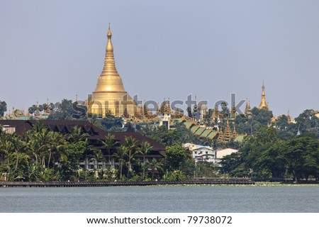 The Shwedagon Pagoda seen from Kandawgyi Lake, Yangon, Burma, Myanmar, Southeast Asia - stock photo