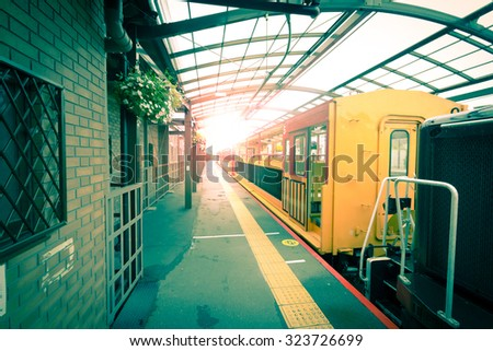 The side of the train Passengers waiting at train station - stock photo