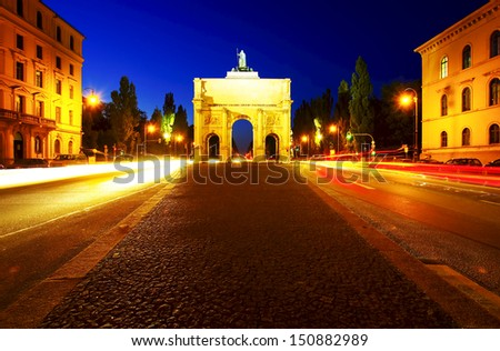 The Siegestor in Munich, Bavaria, Germany (Victory Gate), three-arched triumphal arch crowned with a statue of Bavaria with a lion-quadriga. Designed by Friedrich von G�¤rtner - stock photo