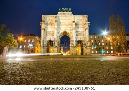 The Siegestor (Victory Gate) at night in Munich, Germany, Europe - stock photo