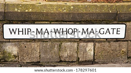 The sign at the entrance to the world's shortest street, Whip-Ma-Whop-Ma Gate; though to derive from the Viking 'Neither one thing nor the other' street
