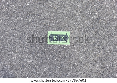 The sign for LPG(LNG) gas pipe on the road(asphalt), japan. - stock photo
