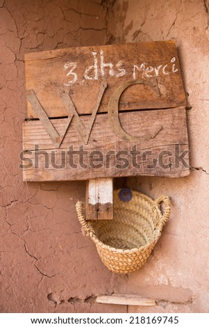 The sign for toilet in Morocco in Ait-ben-Haddou, a fortified city, or ksar, along the former caravan route between the Sahara and Marrakech in present-day. UNESCO World Heritage Site since 1987 - stock photo