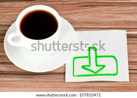 The sign of loading on a napkin and cup of coffee - stock photo
