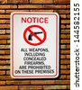 The Sign of no weapon allowed isolated on wall background - stock photo