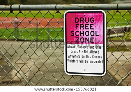 The sign outlines that the school is a drug free zone. - stock photo