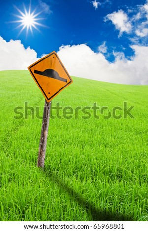 The sign under sunny over blue cloud sky - stock photo