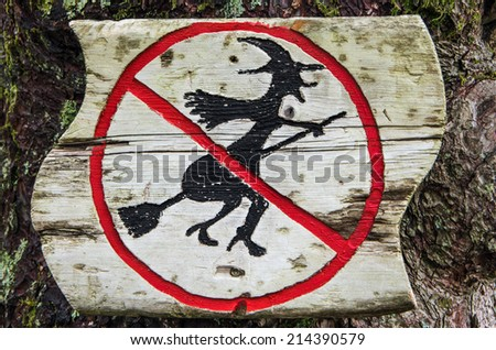 "The sign ""Witch flights are forbidden"" in the forest near Bergen, Norway - Halloween background - stock photo"