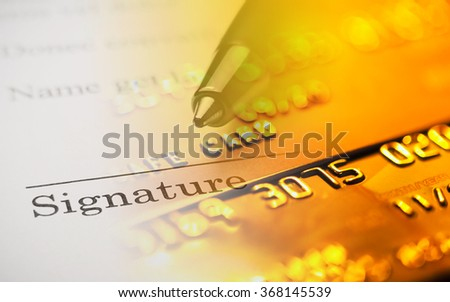 The signature and credit card - stock photo