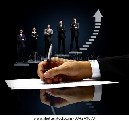 The signing of the document. on the background of business people - stock photo