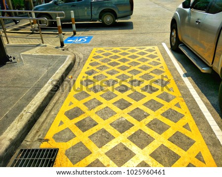 The signs of no parking in this channel and channel for wheelchair on the ground in parking area