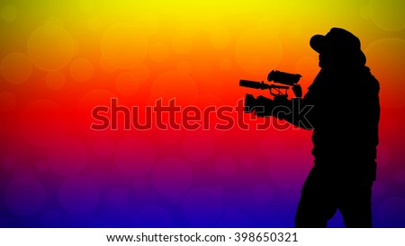 The silhouette of a man holding a video camera.