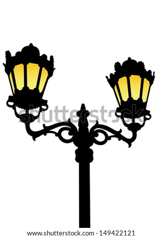 The silhouette of an old-fashioned street lamp with lighted yellow light on a white background / Old-fashioned street lamp - stock photo