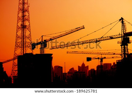 The silhouette of Construction crane