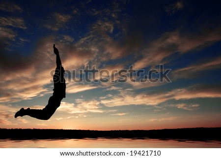 the silhouette of jumping man - stock photo