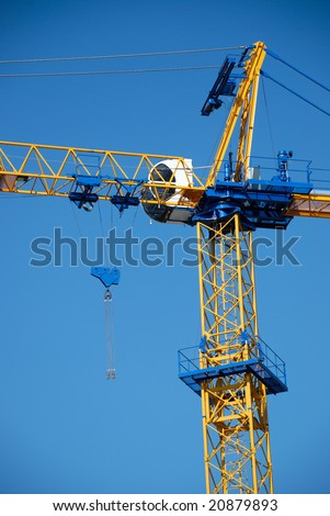 The silhouette of new blue construction crane - stock photo