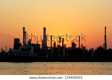 The silhouette of oil refinery at sunrise in Bangkok, Thailand - stock photo