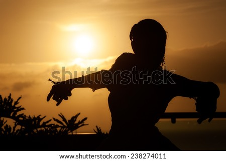 The silhouette of the girl, at sunset. Tenerife, Spain. - stock photo