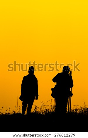 The silhouette of the traveler take a picture - stock photo