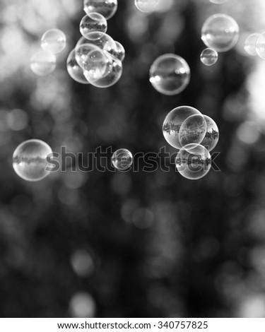 The silver bubbles from the bubble blower - stock photo