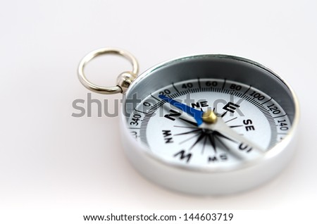 The Silver Compass isolated on white background. - stock photo
