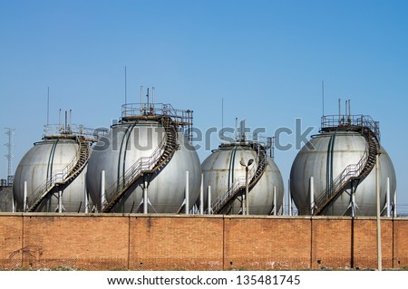 The silver huge storage tanks.
