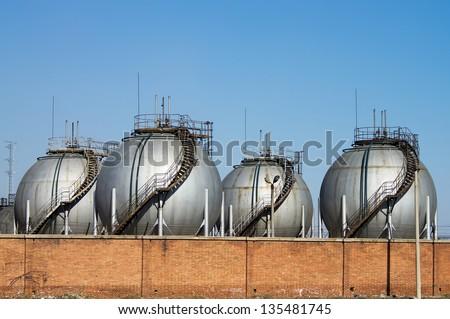 The silver huge storage tanks. - stock photo