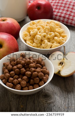 The simple food composition with apples and corn flacks - stock photo