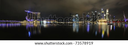 The Singapore skyline at night from across the bay. - stock photo