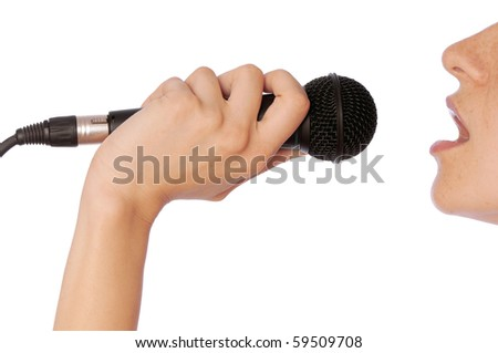 The singer sings a song in a microphone - stock photo